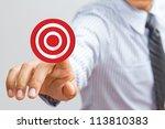 Business man pressing on target goal - stock photo