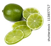 Limes, sliced and whole, isolated on white background. - stock photo