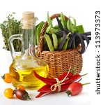 Fresh vegetables and jug of olive oil. - stock photo