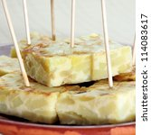 closeup of a plate with a typical spanish tortilla de patatas served as tapas - stock photo