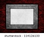 Picture frame on rough background - stock photo