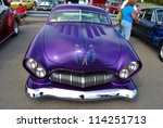 FREDERICK, MD -SEPTEMBER 16: 1950 Purple Ford Coupe Frontal Design Detail at a Car Show on September 16, 2012 in Frederick, MD USA. A Alzheimer's Benefit Car Show in Maryland. - stock photo