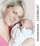 Young mother with her crying baby. - stock photo