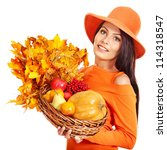 Woman holding autumn basket with fruit and vegetable. Isolated. - stock photo