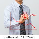 business man writing cost reduction concept - stock photo
