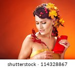 Woman with  autumn hairstyle and make up. - stock photo