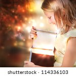 Happy Blonde Girl Opening a Present Box - stock photo