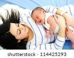 Happy mother with newborn baby - stock photo