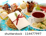 polish christmas eve table with white wafer on plate with hay and traditional dishes - stock photo