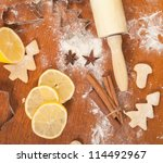 Christmas baking background with dough, spices and cookie cutt - stock photo