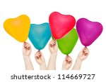 Hands hold color balloons in the shape of heart. Isolated on white background. - stock photo