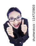 Happy businesswoman showing her thumbs up with big smile - stock photo