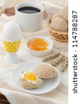 breakfast with muffin, cheese, jam and egg - stock photo