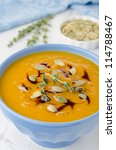 Pumpkin soup with pumpkin oil and seeds close-up - stock photo