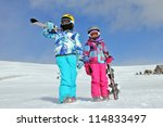Girls with ski on the snow - stock photo