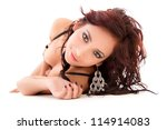 Sexy woman with beautiful face posing on the floor - stock photo