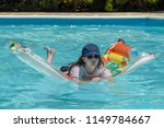 Teenaged girl leaning on an airbed in a swimming pool - stock photo