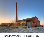 Abandoned factory in a winter landscape - stock photo