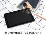 Model of the house on blueprints, digital tablet and pencil. Architect's workplace. Choose from interior variants. You may place your own screen, for example web page on tablet screen. - stock photo