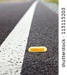Cat's eye road marking close-up - stock photo