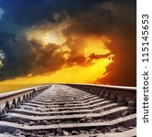 railroad to dramatic sunset - stock photo