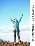 Happy blissful hiker woman in winning / success concept. Hiker woman cheering joyful in bliss with arms raised in the sky after hiking to mountain top summit above the clouds. Asian female model. - stock photo