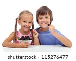 Happy healthy kids eating fresh blackberries - isolated - stock photo