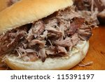 Pulled pork in a soft white bread roll - stock photo