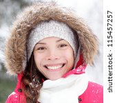 Winter woman portrait closeup outdoors in snow. Happy beautiful smiling mixed race Asian Caucasian girl. - stock photo