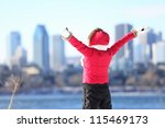 Happy winter woman in city excited and cheering with arms raised in happiness. Beautiful young woman and Montreal City skyline, Quebec, Canada. - stock photo