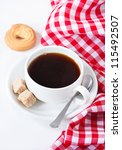 Cup of coffee and sugar cookie. - stock photo