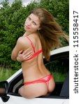 The sexual girl in bikini with car - stock photo