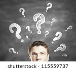 businessman with question mark  on a gray background - stock photo