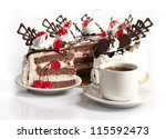 chocolate cake with cherry and  cup of coffee on white background - stock photo
