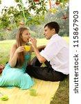 Man feeding a woman under a tree cake - stock photo