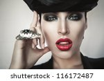 close-up portrait of hot woman in black hat - stock photo