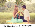 Young couple drinking tea on a picnic - stock photo
