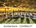 Venice dramatic scene with gondolas at sunset, Italy - stock photo