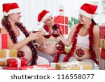 Group of pregnant women with Santa hat drinking wine - stock photo