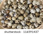 Quail eggs in a basket at a farmers market - stock photo