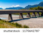 The old wooden bridge across the river Rhine on the border of Liechtenstein and Switzerland - stock photo