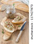 confit of caramelized shallots on a piece of baguette - stock photo
