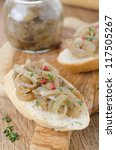 confit of caramelized shallots on a piece of baguette closeup - stock photo