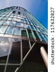 highrise with sky reflections in the glass facade - stock photo