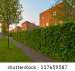 Suburban street with modern houses and sidewalk in the Netherlands - stock photo
