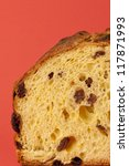 Texture of Panettone, a typical Christmas cake over a red background - stock photo