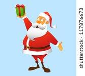 Santa Claus holding a gift at arm, full-length - stock photo