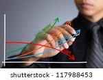business man writing industrial product and service improvement concept - stock photo