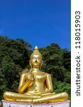 The big golden Buddha statue on hill with blue sky background, Phuket, Thailand - stock photo