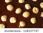Chocolate flows with nuts - stock photo